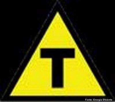 s�mbolo dos transg�nicos: a letra T em preto dentro de um tri�ngulo amarelo.